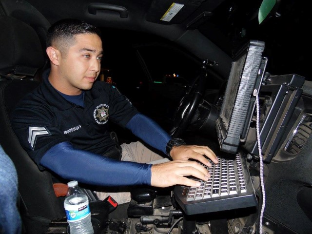Student Using Police Car Computer